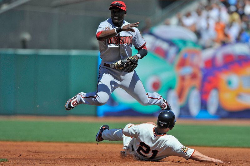 16 April 2008:  John Bowker slides into Orlando Hudson, but Hudson turns the double play during the Arizona Diamondbacks' 4-1 victory over the San Francisco Giants at AT&T Park in San Francisco, CA.
