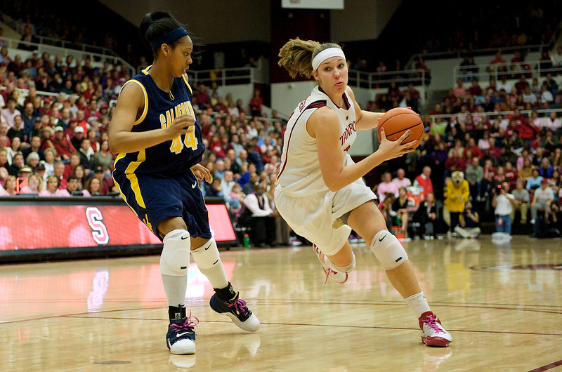 14 February 2009:  Stanford Cardinal forward Kayla Pedersen (14) drives past California Golden Bears forward Ashley Walker (44) during the No. 6-ranked Cardinal's 58-41 win over the No. 3-ranked Golden Bears at Maples Pavilion in Stanford, California.