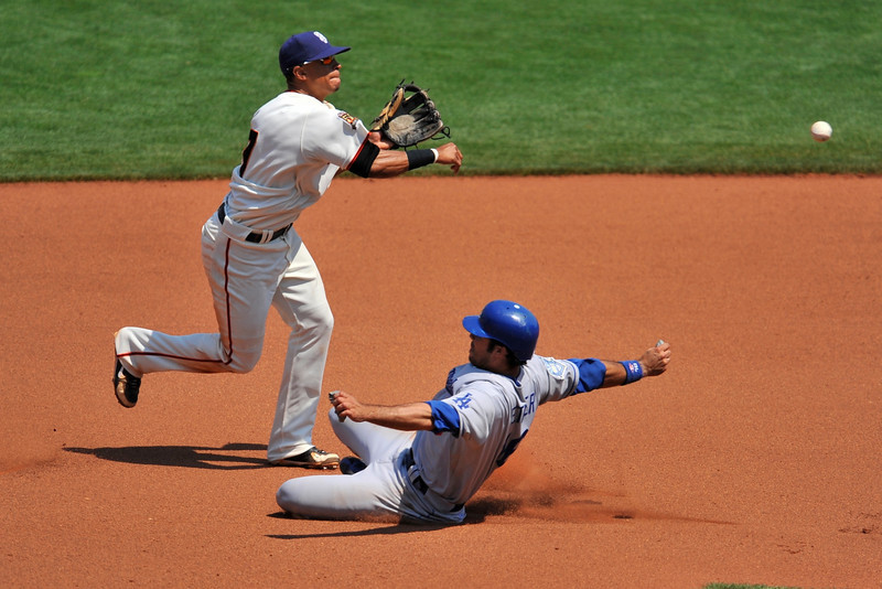 06 July 2008:  Emmanuel Burriss (7) turns a double play and avoids the hard slide from Andre Ethier (16) during the Los Angeles Dodgers' 5-3 win over the San Francisco Giants at AT&T Park in San Francisco, CA.