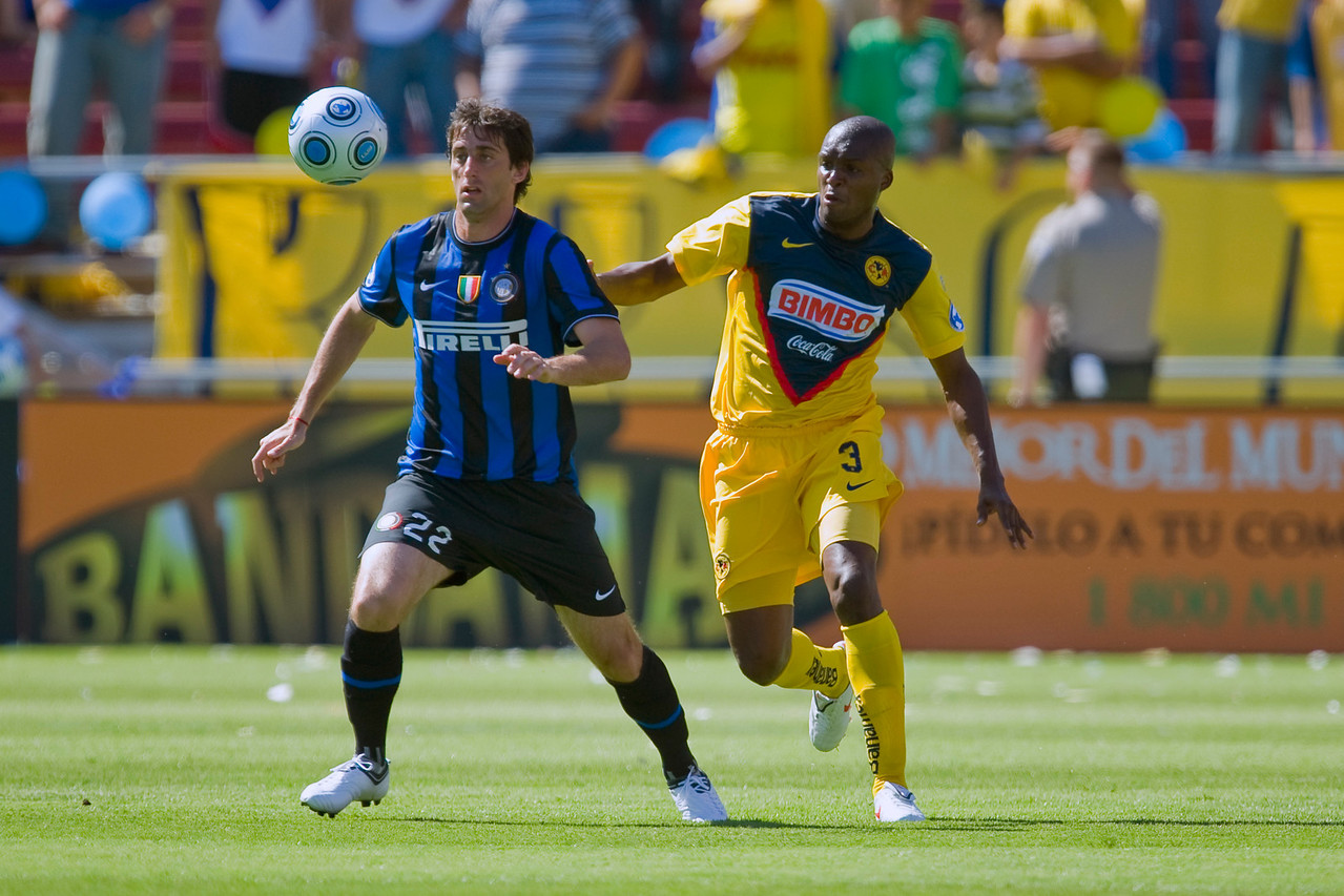 19 July 2009:  Inter Milan forward Diego Alberto Milito (22) controls the ball in front of Club America defender Aquivaldo Mosquera (3) during play in the World Football Challenge match between Club America and Inter Milan at Stanford Stadium in Stanford, California.  Club America prevailed 1-1 on penalty kicks.