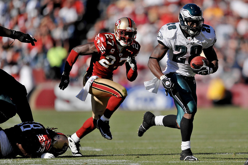 Oct. 12, 2008; San Francisco, CA, USA; San Francisco 49ers cornerback Walt Harris (27) chases Philadelphia Eagles running back Correll Buckhalter (28) during the fourth quarter of the Eagles' 40-26 victory over the 49ers at Monster Park in San Francisco, CA. Mandatory Credit: Daniel R. Harris-US PRESSWIRE