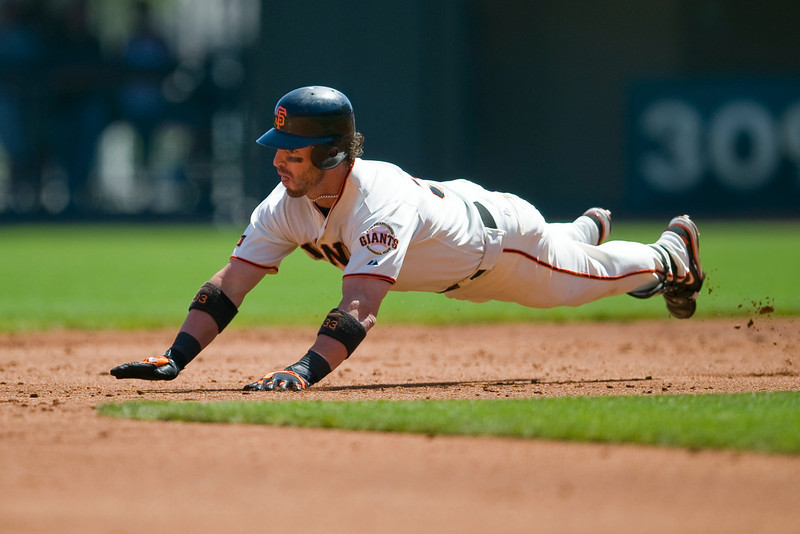 07 September 2009:  San Francisco Giants center fielder Aaron Rowand (33) dives head first into second base after a second inning double during the Giants' 9-4 win over the San Diego Padres at AT&T Park in San Francisco, CA.