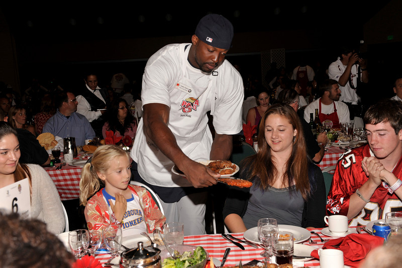 Table 06:  Manny Lawson serving dinner at the San Francisco 49ers Pasta Bowl II charity event in Santa Clara, CA.