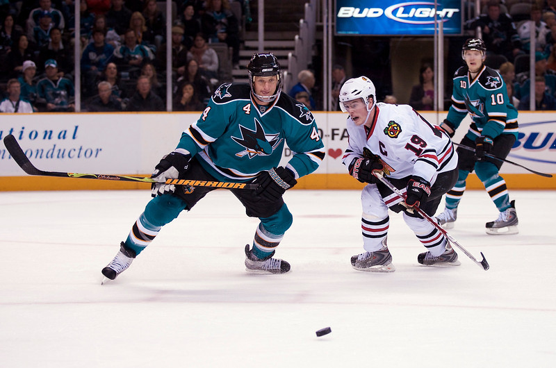 31 January 2009:  San Jose Sharks defenseman Rob Blake (4) and Chicago Blackhawks center Jonathan Toews (19) pursue the puck during the third period of the Blackhawks' 4-2 win over the Sharks at HP Pavillion in San Jose, California.  **** Editorial Usage Only *****