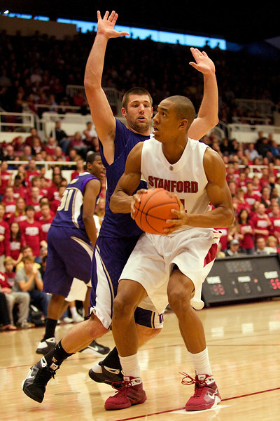 08 February 2009:  Stanford Cardinal forward Josh Owens (24) prepares to shoot in front of Washington Huskies forward Jon Brockman (40) during the second half of the Cardinal's 75-68 loss to the Huskies at Maples Pavilion in Stanford, California.