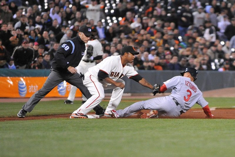 10 April 2008:  Jose Castillo (12) tags out Cesar Izturis (3) at third base during the San Francisco Giants' 5-1 win over the St. Louis Cardinals at AT&T Park in San Francisco, CA.