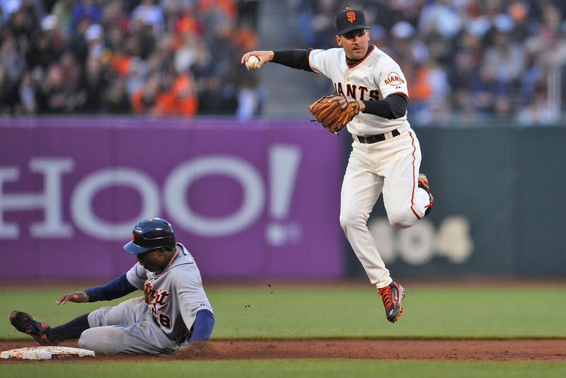 16 June 2008:  Omar Vizquel (13) turns a double play as Curtis Granderson (28) slides into second base during the San Francisco Giants' 8-6 victory over the Detroit Tigers at AT&T Park in San Francisco, CA.