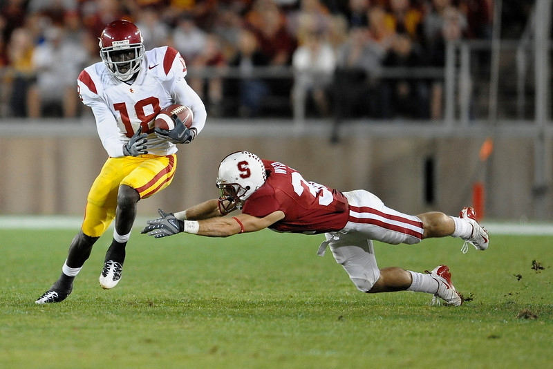 15 November 2008: USC wide receiver Damian Williams (18) eludes Stanford safety Sean Wiser (32) during the USC Trojans' 45-23 victory over the Stanford Cardinal at Stanford Stadium in Stanford, CA.