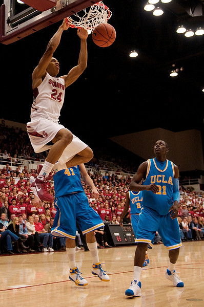 26 February 2009:  Stanford Cardinal forward Josh Owens (24) leaps for a dunk in front of UCLA Bruins forward Nikola Dragovic (41) during the Bruins' 76-71 win over the Cardinal at Maples Pavilion in Stanford, California.