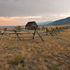 Fenced In<br /> Plenty of forest fires in Idaho made Montana hazy through the summer.  This evening, orange haze slowly settled around everything.  My lonely old cabin sat in the center of the valley watching time pass.