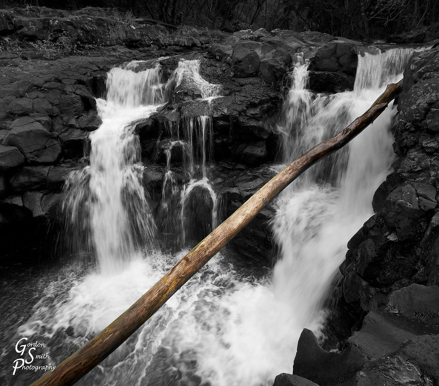 Hoopii waterfall with some selective coloring to a fallen tree that reached up from the deep plunge pool
