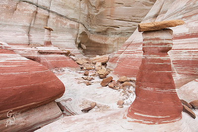 House of Hoodoo Mr. and Mrs. Hoodoo invited me to their home today, decorated with red and white stripes and jumbles of rocks for furniture.  These two hoodoos are such a pretty pair!