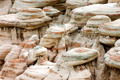 Green, brown and white stripes cover everything in Sidestep Canyon.  This close-up of some rounded rocks shows off varied colors.
