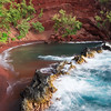Red Sand Beach, Maui<br /> Soft morning light touches the rocks, ocean and red sand on this Hana Beach, Hawaii.