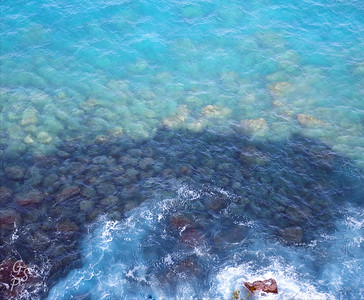 The north shore of West Maui has cliffs that overlook the ocean far below.  The blue water and submerged rocks are hypnotic!