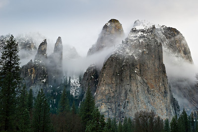 "3/2 ""Cathedral Spires and Rocks in Winter"". Just back from another fantastic weekend in Yosemite including the Yosemite Renaissance reception! I did get out to take pictures in between the bad weather. This morning was perfect...the clouds and fog were swirling around the spires and rocks here with a hint of blue sky peeking through! The two spires on the left, I believe, are called the Lower and Higher Cathedral Spire, while the the two on the right are the Higher Cathedral and Middle Cathedral Rock. I can just imagine seeing the climbers ascending those later this Spring."