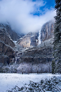 Light on Yosemite Falls.  After a fresh snowfall in Yosemite, I went out taking pictures the next morning.  The storm was just beginning to clear with a glint of sunlight highlighting Yosemite falls.  A touch of blue skies were peeking through!  Such an incredible place to be in the winter!    My Facebook Fan Page can be found here:  http://www.facebook.com/pages/Yosemite-and-Bay-Area-Nature-Photography-by-John-Harrison/190152125697?ref=mf