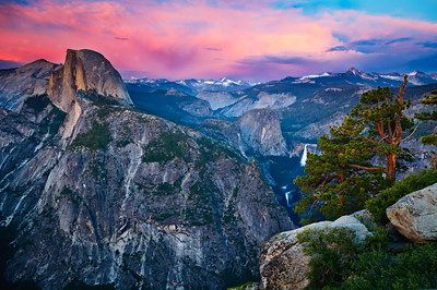 """11/8/09.  """"Sunset on Half Dome from Glacier Point"""" Some nice color in the summer sky with clouds above Clouds Rest and Nevada and Vernal Falls. It was uncertain if we were going to get a good sunset as high clouds hid the sun from penetrating through. These last glimpses were at dusk as the sky started to light up. This is one of those places I want to be on a Friday afternoon!  Sept 8 -2011. Thanks for all the positive comments folks!  Love it. This image looks great as a 40x60 as well!  If you want to follow more of my photography, my Facebook Page has most of my latest images here. Thanks again!  John  https://www.facebook.com/pages/Yosemite-and-Bay-Area-Nature-Photography-by-John-Harrison/190152125697"""