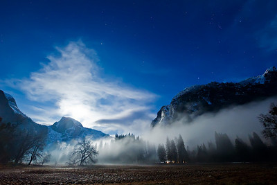 "3/9  ""Full Moon Rising over Half Dome"" The clouds and fog were pretty thick along the ground as we were coming back from a day of shooting in Yosemite National Park last weekend. The full moon was rising behind Half Dome and created an ominous glow with the clouds. For the photo techies... I captured this with the Nikon D3S @12,800 ISO, f/8 and 4s and the 14-24 lens that I rented for the last trip. Sure would LOVE to own this camera, but at $5200 for the body and $1800 for the lens, I am going to have to wait a while. Pretty amazing to push something to that ISO! I DID run this through two passes of a noise filter (Noiseware Pro) in Photoshop.  Thanks for all the support and comments!  Sorry if I haven't been able to reply individually.   To follow the latest on my photo endeavors, you can check out my Facebook Fan page here:  http://www.facebook.com/pages/Yosemite-and-Bay-Area-Nature-Photography-by-John-Harrison/190152125697?ref=nf"