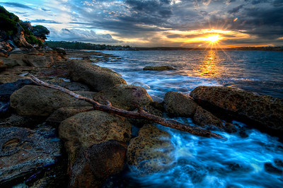 12/2.  Royal National Park in Australia at Sunset.  I captured this during my fantastic business trip to Australia where I managed to get out to take a few pictures as well.  This was one of my FAVORITE locations!   One of my friends, Matt, who lives in Sydney took me out there.   It rained on us, was hot and sunny and then the sunset was just fantastic!  I couldn't have asked for anything more.  I was definitely having a little TOO much fun as I kept shooting past sun down... and the tide kept coming UP!!  We made it back around cove without any problems!  I just finished processing this today for my first time -- let me know what you think.