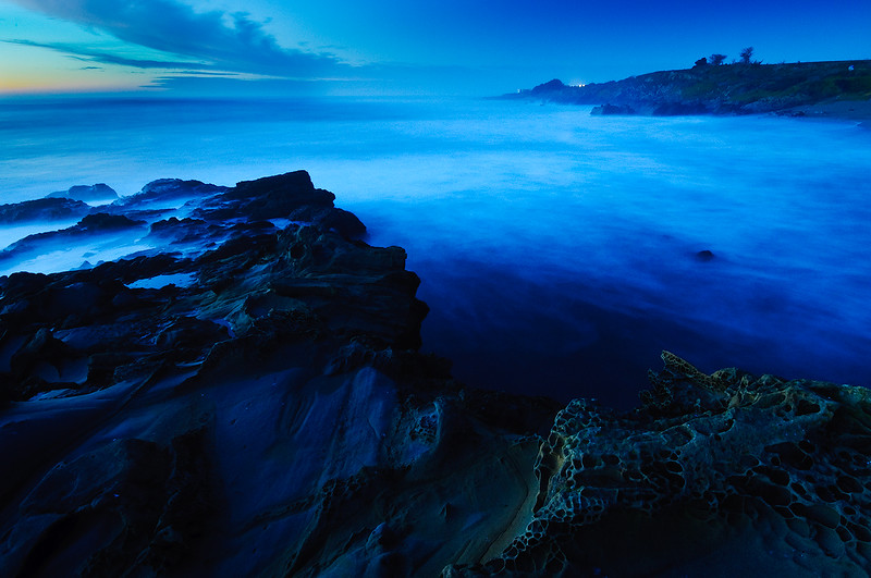 """1/11/10 """"Edge of the World""""   Northern California Coastline at Dusk.  The waves smooth and ethereal, the rocks looking like they were from another planet.  This is a long exposure at dusk that I shot last night.  I love the blue tones that come out at dusk and the smooth waves from the long exposure.  More of my images can be found in my gallery or also join my Facebook Fan page <a href=""""http://www.facebook.com/pages/Yosemite-and-Bay-Area-Nature-Photography-by-John-Harrison/190152125697"""">http://www.facebook.com/pages/Yosemite-and-Bay-Area-Nature-Photography-by-John-Harrison/190152125697</a>."""