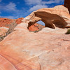 Thunderstorm Arch and Blue Sky<br /> a mixture of pink, orange, red and white, kind-of like some candy I can think of.