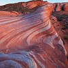 Fire at Night<br /> Fire Wave of Valley of Fire glows hotter just as the sun sets.  I sat and waited for the sun to go down.  As it did, the rocks seems to gradually glow more and more, as if they had been turned on magically.