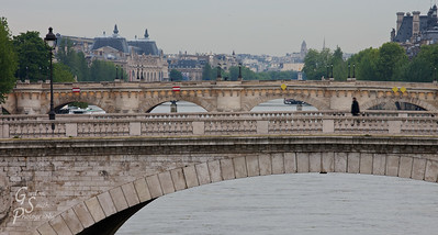 Morning Walk across a Paris Bridge.  The Musee d'Orsay is in the background