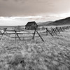 Fenced In --Black and White Version<br /> Plenty of forest fires in Idaho made Montana hazy through the summer.  This evening, orange haze slowly settled around everything.  My lonely old cabin sat in the center of the valley watching time pass.
