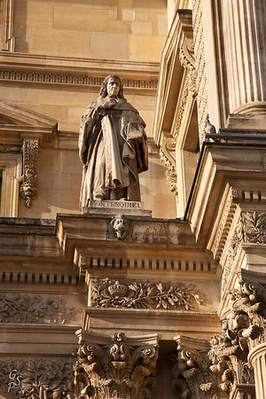 Statue Perch This statue of Montesquiel is perched high on the Louvre castle walls, up with the birds.  He sits above some ornate columns.