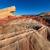 Sculpted Land<br /> near Fire Canyon Arch in Valley of Fire.  The sandstone lines streak across the ground while the gorgeous arch truly lights up in the late winter sky.