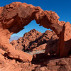 Conformity<br /> The sharp angles of this arch conform to the distant desert rocky peak.