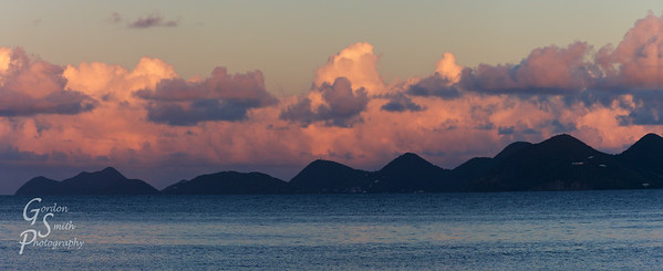 Tortola Sunrise as seen from Peter Island in the south.  A huge collection of towering clouds and the towering peaks of the island made a great panorama in the morning.