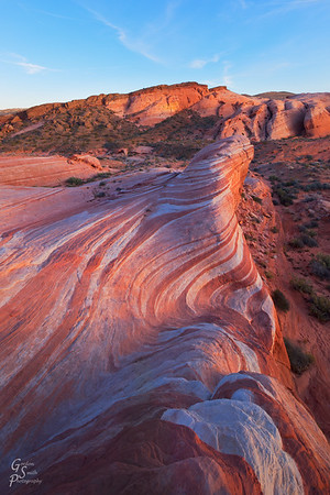 Folded Fire The Fire Wave (or Firewave) in Nevada's Valley of Fire state park lights up at sunset with reds and oranges that don't come out at other times of the day.  The rock folds back and forth on itself as if it were alive.  The sight is spectacularly beautiful
