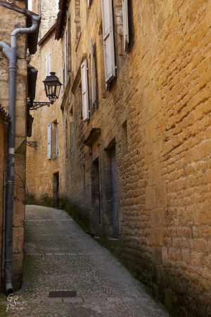 Sarlat Narrow Street Perfect for walking, Sarlat is beautiful in every direction from the town center.  We got lost and still loved every minute.  This narrow street with windows, lanterns and cobblestones is typical of the gorgeous town.