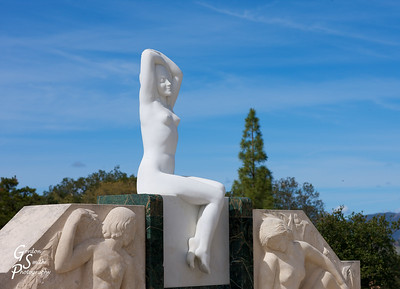 Statue Stretching Sky-ward at Hearst Castle.  The blue sky and relaxed expression of this figure attracted me.