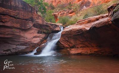 Verdant Desert Waterfall