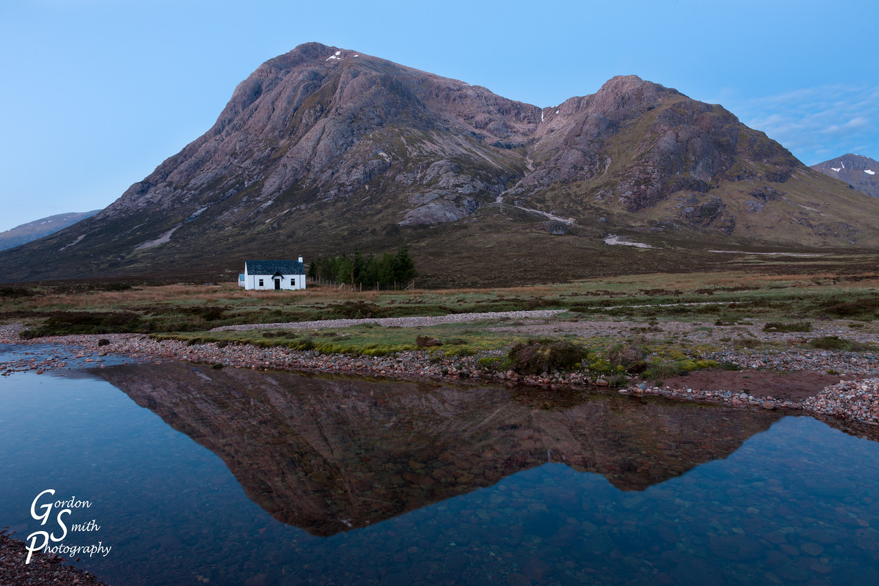dawn cottage and mountain reflection in the water