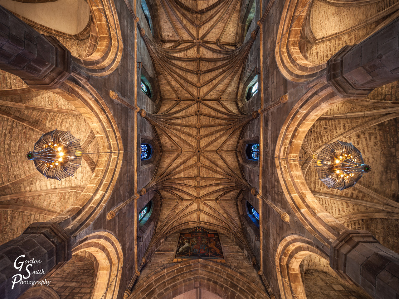 ceiling with columns, vaults and stained glass