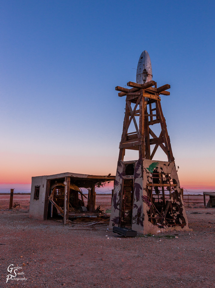 Salton Sea tower ruins with rocket on top