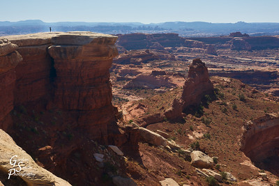 One of my favorite shots from Canyonlands, my wife wandered out to the furthest point south anyone can go in the Islands in the Sky section:  White Crack.  She totally raised her arms in joy and amazement.  I happened to be taking a photo at the same time:  nothing was posed at all.  That's how awesome the view is here!  Please view in its' largest size to fully enjoy.