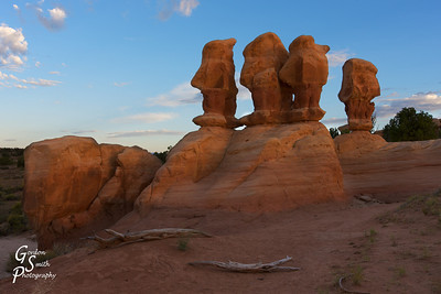 """Talking Heads  Another sunrise shot from the Devil's Garden.  These """"heads"""" are about 12-14 feet tall (not counting their pedistal) and lovely shapes.  I walked all around them and tried to get different shots.  The light lightly touching the rocks makes this one special in my opinion.  Thanks for your support and comments everyone."""