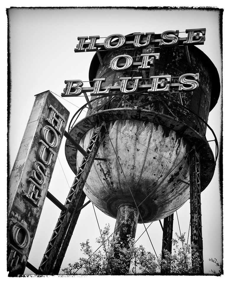 7/13/11 : The House of Blues water tower…  I often battle with finding the differentiation between inspiration and plagiarism.  This is a case in point.  I follow a podcast called The Art of Photography by Ted Forbes.  As its name suggests, it is more about the artistic side of photography, and less about gear and technical jargon – and Ted is really into his black and white processing.  He also uses more film (whatever that may be) than pixels.  <br /> <br /> In one of the shows where he was actually discussing mounting pictures, he showed a simply composed water tower in black and white.  I really liked the approach – back lit, at an angle, and in black and white.  This image takes a lot from that picture, but is it simply inspiration, or is it plagiarising a better artists work ?  I don't have the answer – possibly some of you may have seen Ted's image (it's behind him in most of the resent podcasts), and may have a comment …