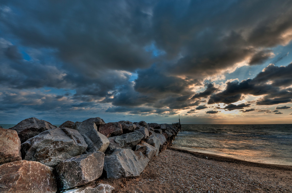 7-10-11 : One final one from Evanston beach.  This rocky pier caught my eye as I was leaving, and I shot off a series of exposures not really thinking about it too much.  I finally got to processing the HDR image, and it turned out pretty well, so I think I'll keep it.<br /> <br /> Thanks to everyone for the comments on the multi-coloured tree yesterday.