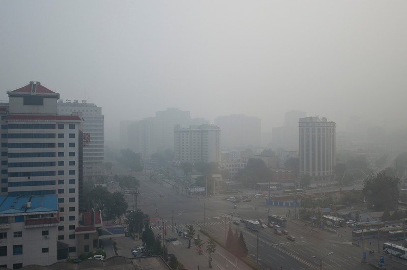 """Blue Skies in Beijing? This is a normal day in the Chinese Capital. Smoggy, white air. This was taken from the 14th floor in down town Beijing.<br /> <br />  <a href=""""http://sillymonkeyphoto.com"""">http://sillymonkeyphoto.com</a>"""