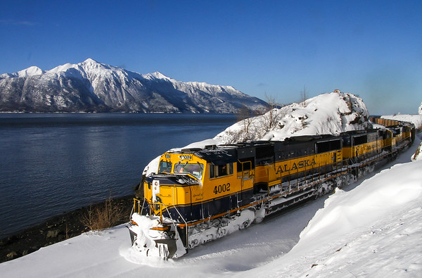 12.14.15: An export coal train winds its way along Turnagain Arm en route to Seward where the coal will be unloaded and shipped to Chile. March is a beautiful time to be in Alaska as the weather is often very nice and combined with the long hours makes for plenty of time to take photographs.
