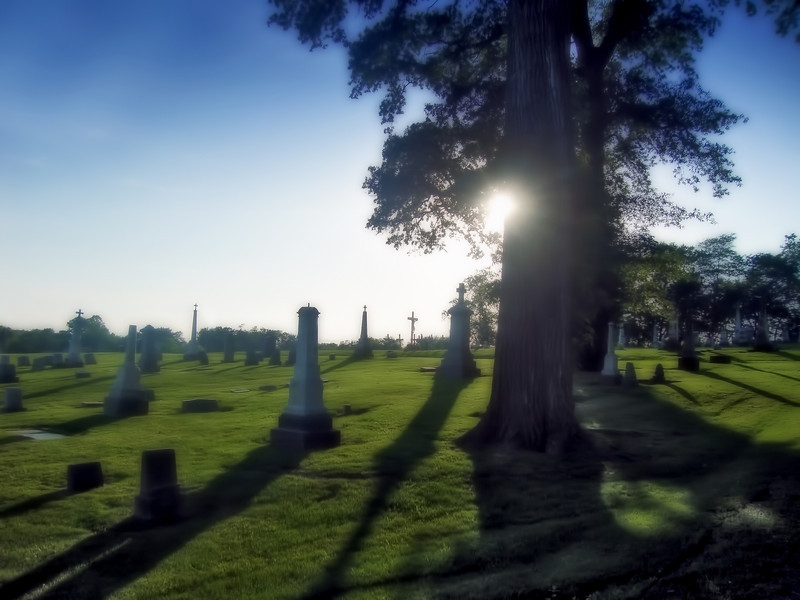 "This is a scene from a cemetery near my home, Walnut Hill. I occasionally drive through there and read the names on the tombstones. Life sure has changed in the last 100 years. The sun was getting low in the horizon and casting dark shadows. Maybe i'm getting a heavy-handed with the Photoshop, but once again I kind of like the ""ethereal"" effect here. Your comments are always appreciated."