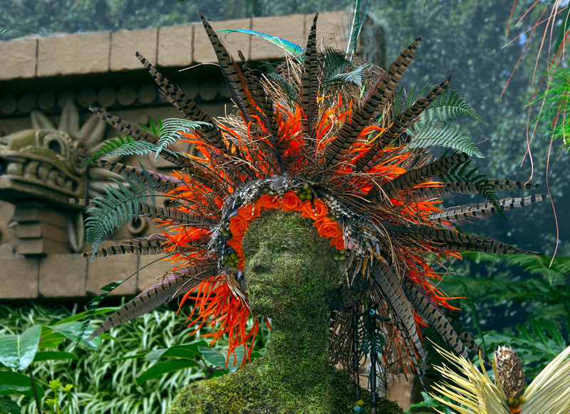 This is one of the Mayan people at MOBOT orchid show. Very impressive head dress. I have to say they were just as beautiful as the orchids. 3/8/11