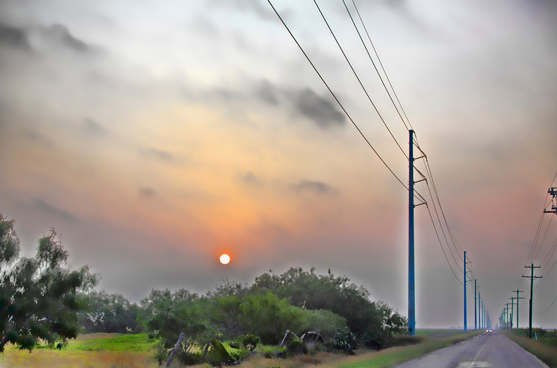 Taken on a misty Sunday morning near Harlingen, Texas. The sun was just coming up and it had a kind of surreal feeling. The light was changing so fast I barely had time to jump out of the Jeep and snap a couple photos before the mood changed. 6.28.12