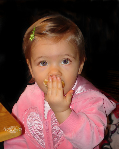 Ran across this photo while looking for something else. Forgot about what I was looking for and decided to use this for my daily. Taylor was such a pleasant beautiful baby. I think she is eating a Ritz cracker here. She still loves to eat. 2.9.11